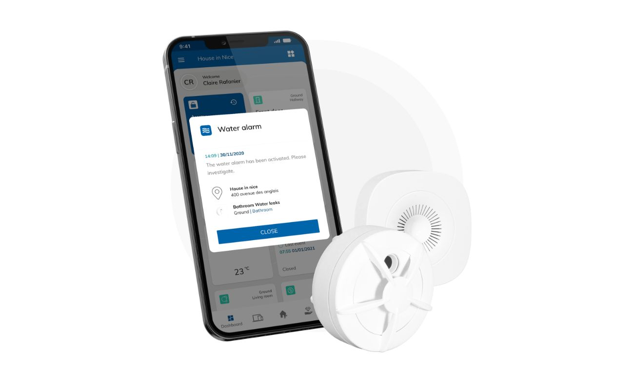 White water and humidity leak detector with black smartphone showing water leak notification