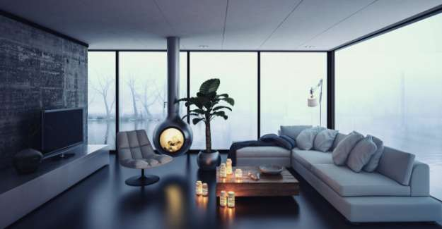 Inside view of a modern style living room with large window shwing a lake outside