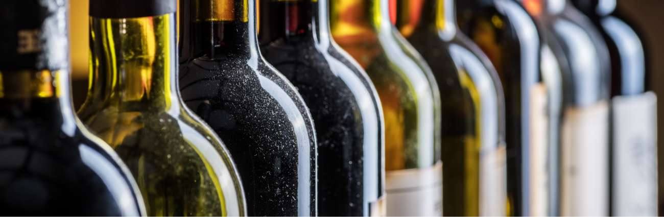A view of several bottles of red wine in row