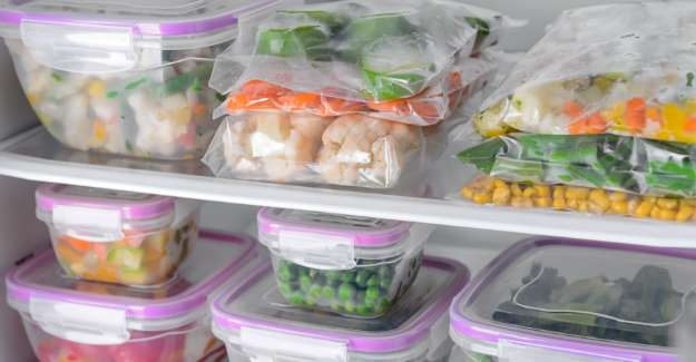 Few plastic contaniers with food inside well placed in freezer