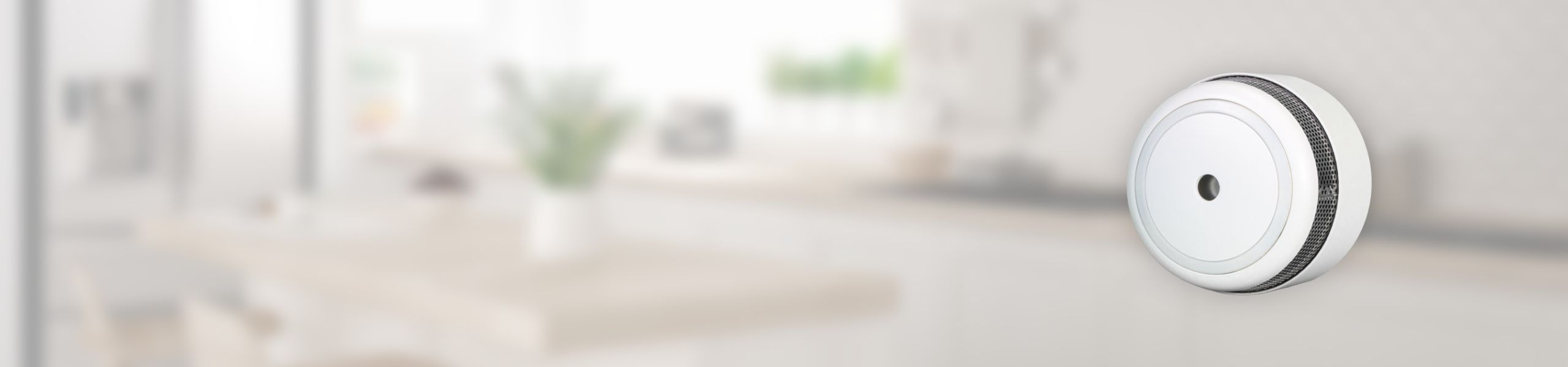 White smoke alarm sensor Nearsens with living room on the background